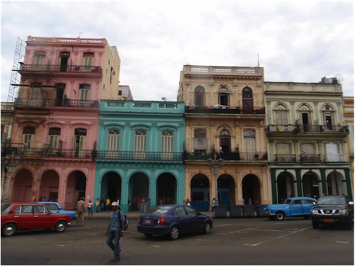 The architecture is Spanish colonial, the cars American and Russian, the people…Caribbean?