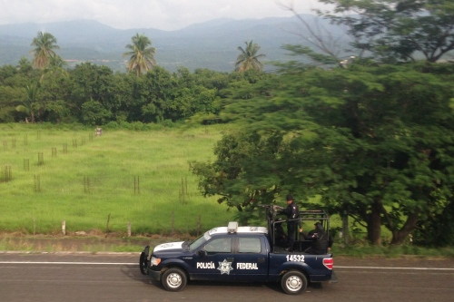 Federal Police Agents Patrolling the road to Uruapan
