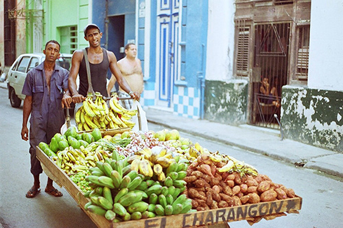 A Produce Vendor wheels his goods through the streets of Havana Vieja, Calling out his offerings