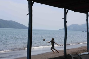 A boy plays soccer on a beach in Arnapala, Honduras. Photo by Danielle Mackey, MA '14