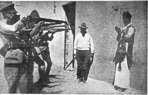 Soldiers in a firing line target a priest during the Cristero War. Source - https://eccechristianus.files.wordpress.com/2012/04/cristeros1-1.jpg